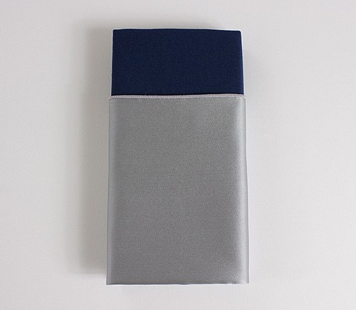 Silver Lamour Dinner Napkin with Navy Cotton Backing